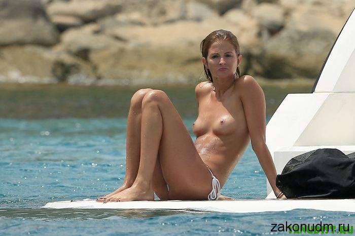 EXCLUSIVE***MINIMUM FEE OF £250 PER PICTURE APPLIES*** Millie Mackintosh is seen on holiday in Ibiza. The reality TV star looked happy and relaxed as she jumped topless in to the sea off the back of her rented boat with friends. 3 August 2014. Please byline: Vantagenews.co.uk